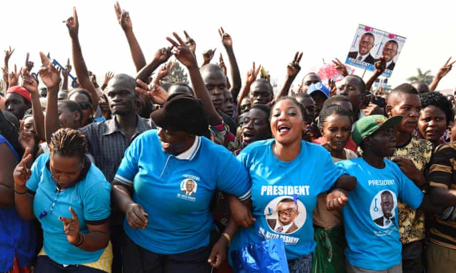 Supporters of opposition presidential candidate Kizza Besigye gather during a political rally in Wakiso District in Kampala
