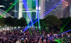 People shine laser beams