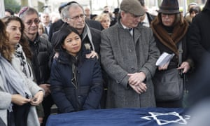 Family members and friends gather at the funeral of Mireille Knoll, who was stabbed to death in her home