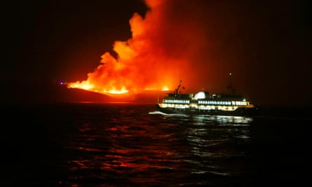 A huge fire seen from the Manly Ferry service burns at North Head on Saturday night.