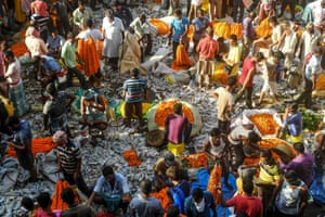 Kolkata, India Hindus gather at a flower market on the day devotees gather to perform Tarpana on the banks of the Ganges to honour the souls of their departed ancestors