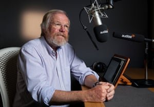 Author Bill Bryson sitting by a mic at the Audible audiobook studio