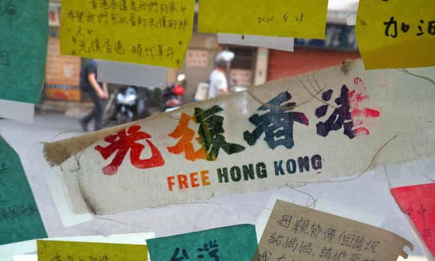 Stickers supporting Hong Kong pro-democracy movement on the glass door of a restaurant in Taipei