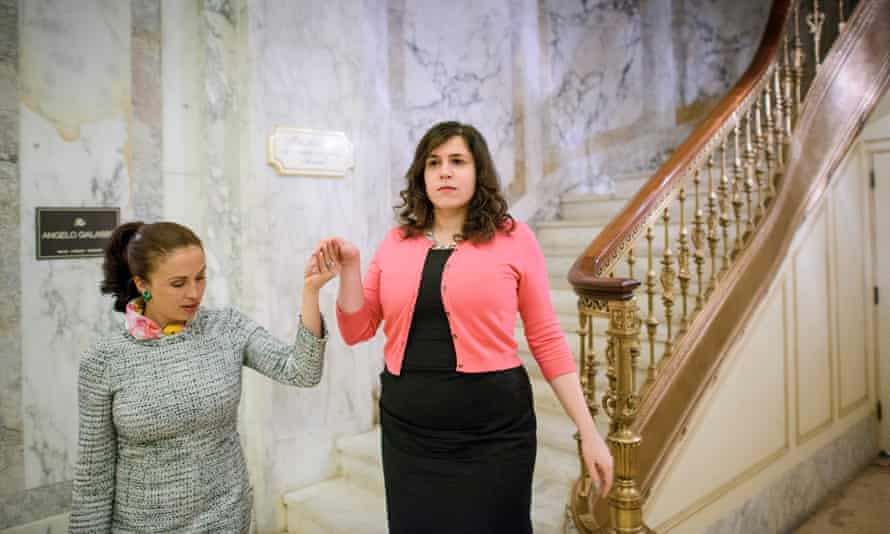 Reporter descending a staircase: Oksman learns the proper way to walk downstairs
