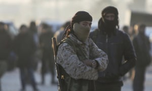 Syrian fighters in a refugee camp in Idlib, Syria