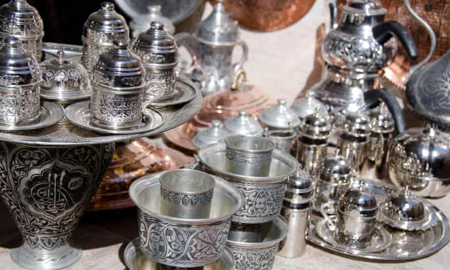 Mardin, Turkey is an area famous for its Syrian Orthodox silver. In this close-up image is a range of silverware, including teapots and teacups.