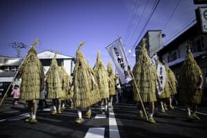 Kaminoyama, Japan Participants dressed in straw coats
