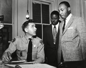King being arrested in 1955 after leading a boycott of segregated buses in Montgomery, Alabama.