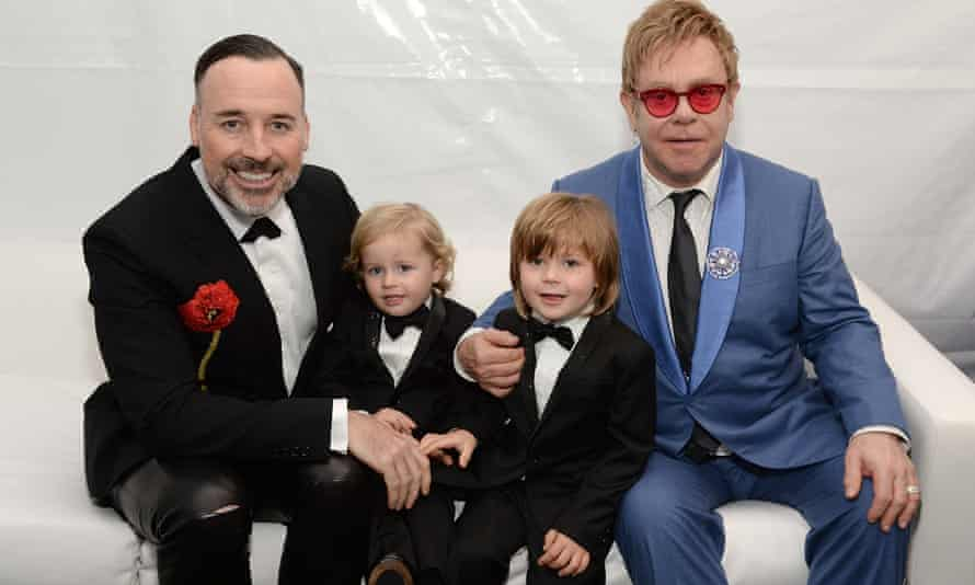 John with husband David Furnish and sons Zachary and Elijah.
