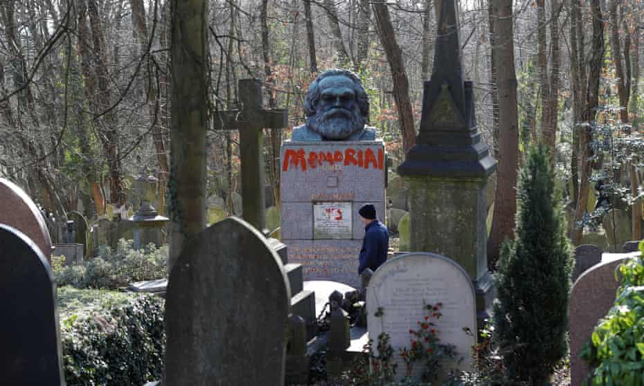 The tomb of Karl Marx in Highgate cemetery, London shows the marks of recent vandalism.