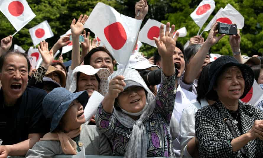 Wellwishers salute Japan's new Emperor Naruhito and Empress Masako.