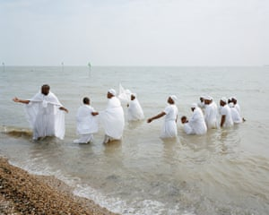 Southend, 3:30pm. A Pentecostal Christian group from London perform a mass baptism on Southend Beach
