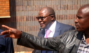 Tendai Biti, centre, leaves Zimbabwe's high court in Harare