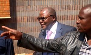 Tendai Biti, centre, leaves Zimbabwe's high court in Harare