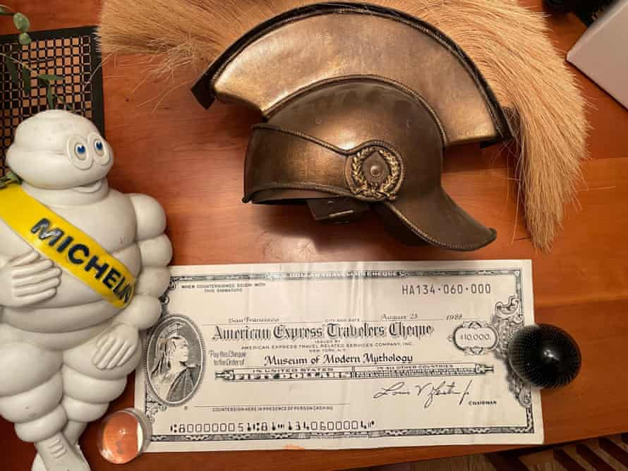 Michelin man with centurion helmet and American Express check