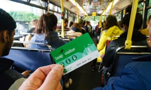 A man holds a Leap card on a Dublin Bus service