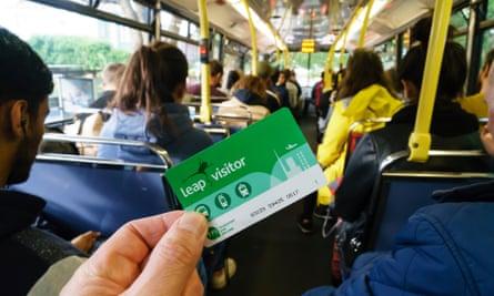 A man holds a Leap card on a Dublin Bus service