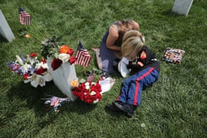 Brittany Jacobs embraces her son, Christian, beside the grave of her husband, US Marine Corps Sergeant Chris Jacobs, at Arlington national cemetery on Memorial Day.