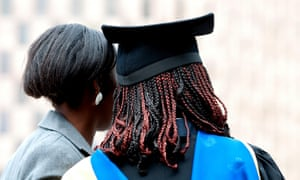 Two students at Coventry University's graduation day.