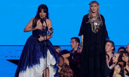 Camila Cabello accepts the video of the year award next to Madonna.