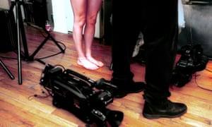 Nude model on an adult film set.