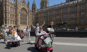 People protest outside the houses of parliament over the axing of the independent living fund