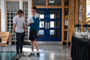 Samuel Clegg (right) looks at his results with friend Jamie Harris at the City of London Freemen's school in Ashtead Park, Surrey