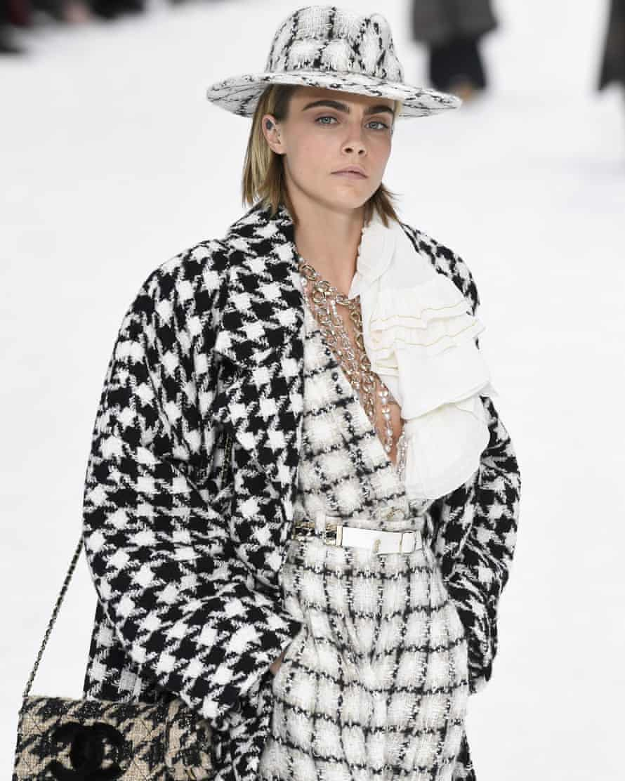 Model and actor Cara Delevingne in Chanel's signature tweed and pearls.