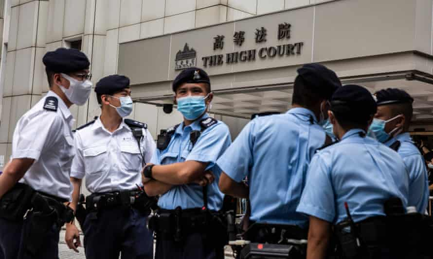 Police gather outside the high court in Hong Kong