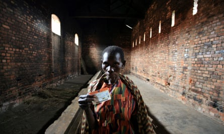 Congolese inmate displays her voter card in a detention cell in Geti prison