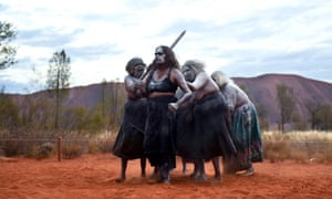 Aboriginal women performing a traditional dance at a cultural event near Uluru in central Australia: should Facebook be deciding whose stories are 'offensive'?