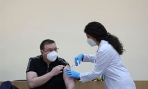 The Bulgarian health minister receives a second shot of the Pfizer/BioNTech coronavirus vaccine in Sofia this week
