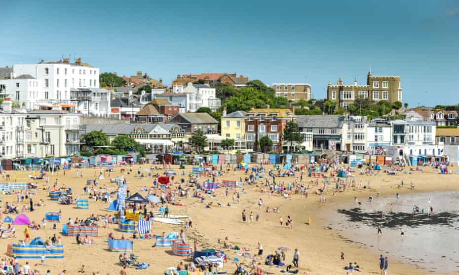 Holidaymakers on the beach at Viking Bay in Broadstairs, Kent