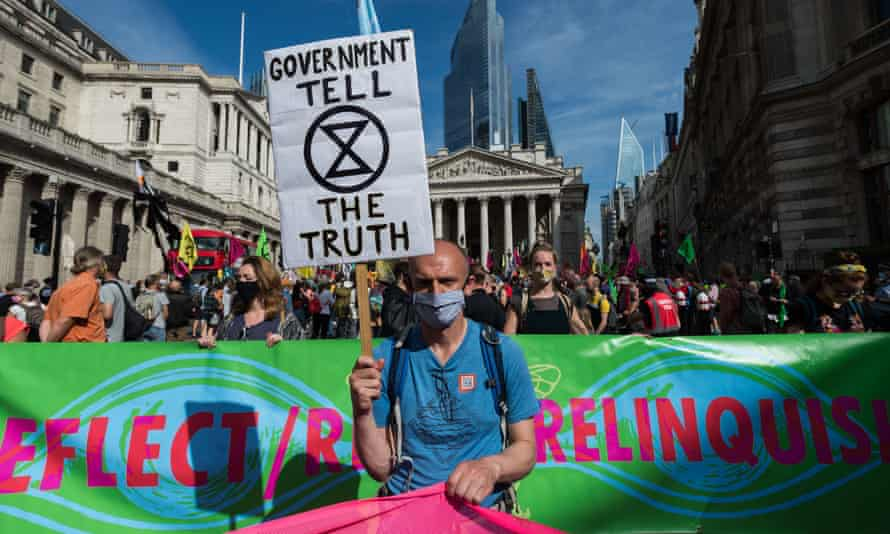 : Activists from Extinction Rebellion gather by the Bank of England ahead of marching through central London on the tenth and final day of mass protest action, on 10 September.