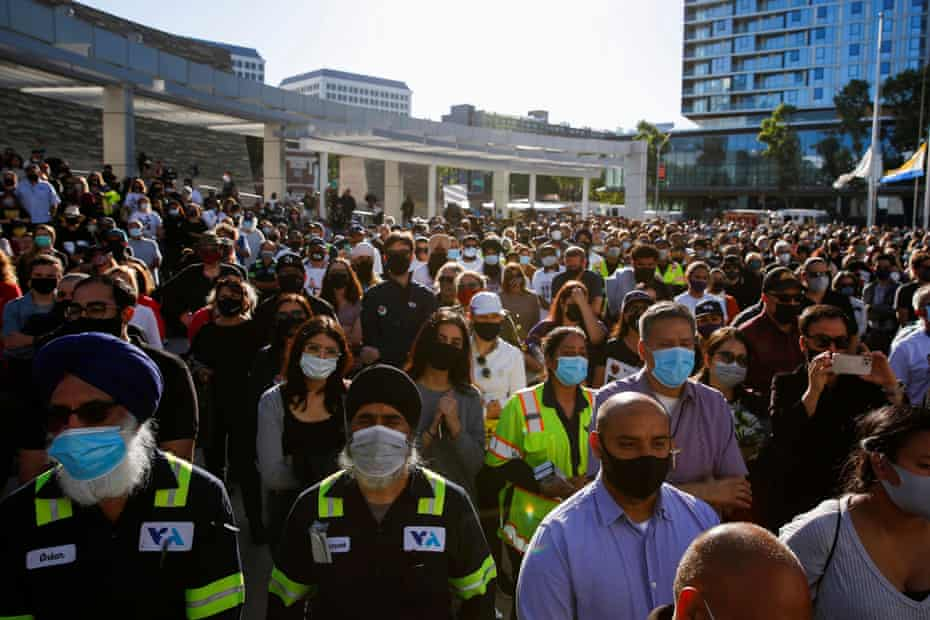 Vigil for Shooting Victims in San Jose People attend a vigil for shooting victims at a rail yard operated by the Santa Clara Valley Transportation Authority in San Jose, California, United States on May 27 2021. REUTERS / Brittany Hosea-Small