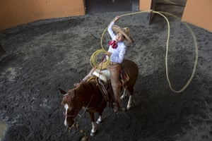Diego Salamanca practises his lasso skills at the Rancho del Charro in Mexico City