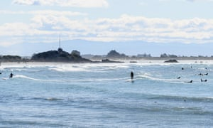 A few surfers take to the water on Thursday.