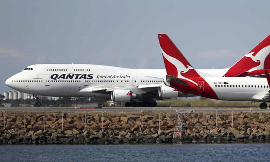 Two Qantas flights arriving at Sydney airport. The government has banned direct travel from China until 29 February.