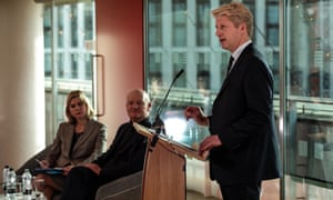 Jo Johnson speaking at the Southbank Centre, with Justine Greening and David Willetts looking on.