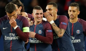 Marco Verratti celebrates scoring the team's fifth goal with team-mates.