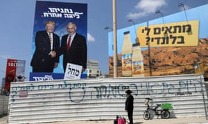 A Likud party campaign banner depicting Benjamin Netanyahu with Donald Trump in Bnei Brak, Israel, on the eve of the second election.