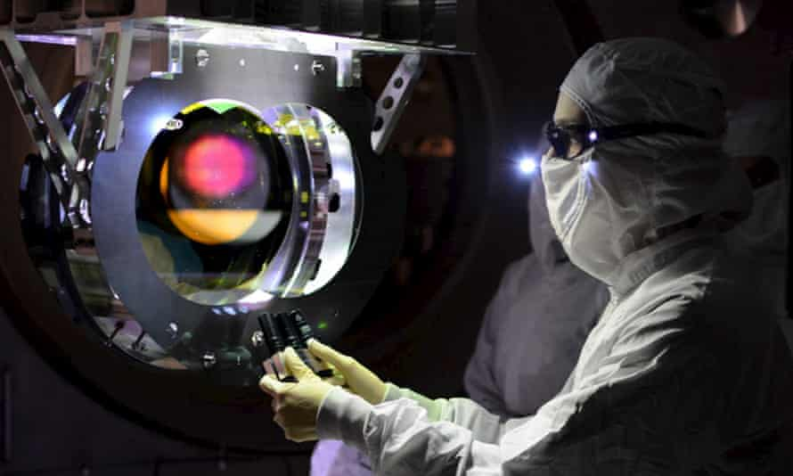 A Laser Interferometer Gravitational-Wave Observatory (Ligo) technician inspects the twin detectors.