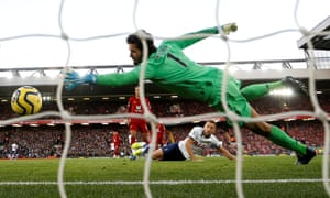 Harry Kane watches his header creep past Alisson to give Tottenham an early lead.