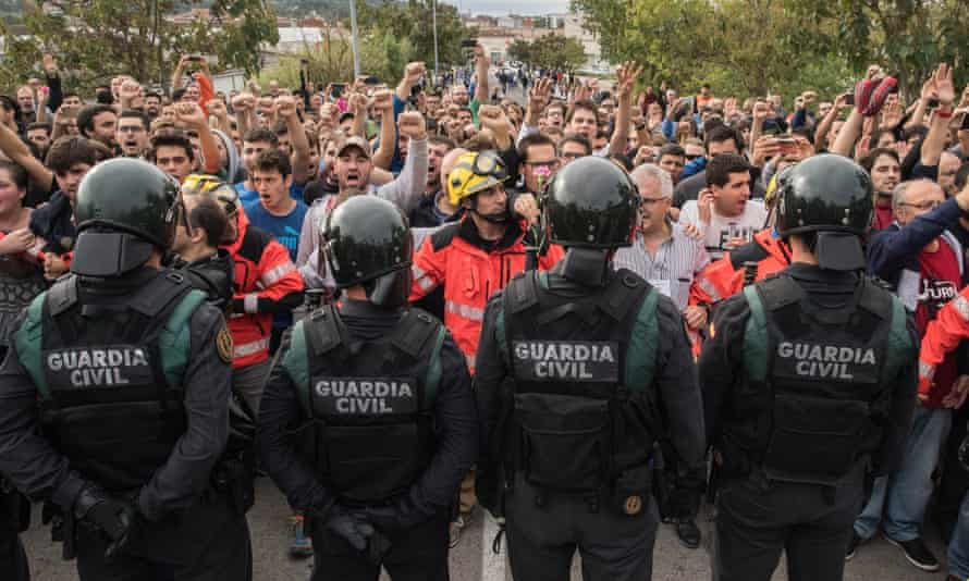 Police face off against voters in Sant Julià de Ramis, Girona, after storming into polling stations to confiscate ballot boxes on the day of Catalonia's independence referendum