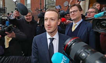 Facebook chief Mark Zuckerberg surrounded by cameras and microphones