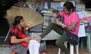 Two people talking in Manila.