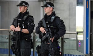 Armed police patrol in Westminster underground station last year