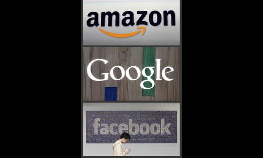 Woman walks by Amazon, Facebook, Google logos.