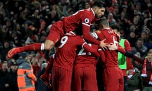 Emre Can jump on to his Liverpool team-mates after Sadio Mané scored against Manchester City.