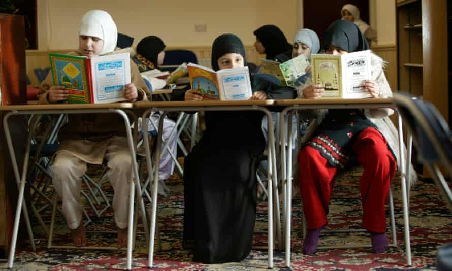 Muslim girls read the Qur'an at madrasa at a Bradford mosque